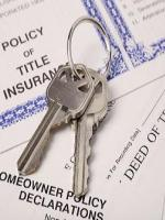 Keys to house with paperwork